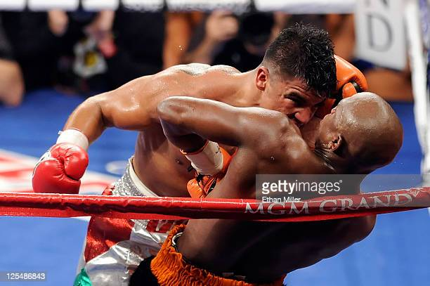 Victor Ortiz reaches his head out as Floyd Mayweather Jr is against the rope in the fourth round during their WBC welterweight title fight at the MGM...