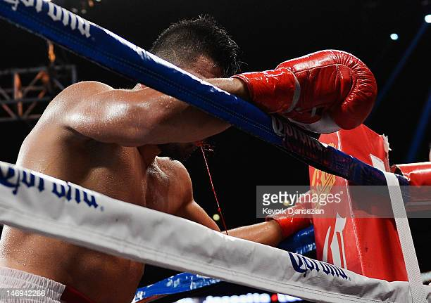 Victor Ortiz spits blood in his corner during the ninth round after having his jaw broken by Josesito Lopez in the 12round fight for the vacant WBC...