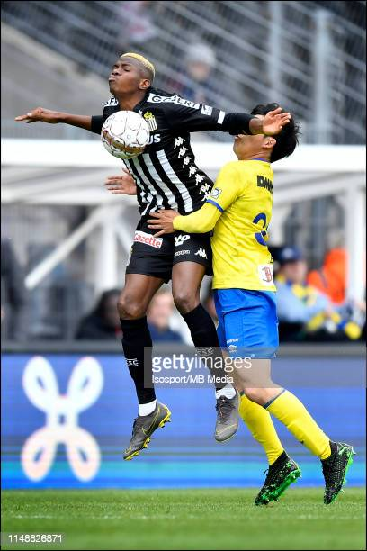 Victor Osimhen of Charleroi and Wataru Endo of STVV fight for the ball during the Jupiler Pro League playoff 2 group A match between Sporting...