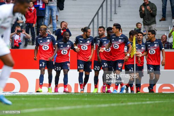 Victor Osimhen of Lille celebrates his second goal with team mates during the Ligue 1 match between Lille and Nantes at Stade Pierre Mauroy on August...