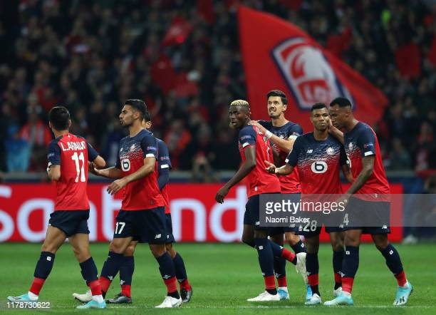 Victor Osimhen of Lille celebrates with his team after he scores his sides first goal during the UEFA Champions League group H match between Lille...