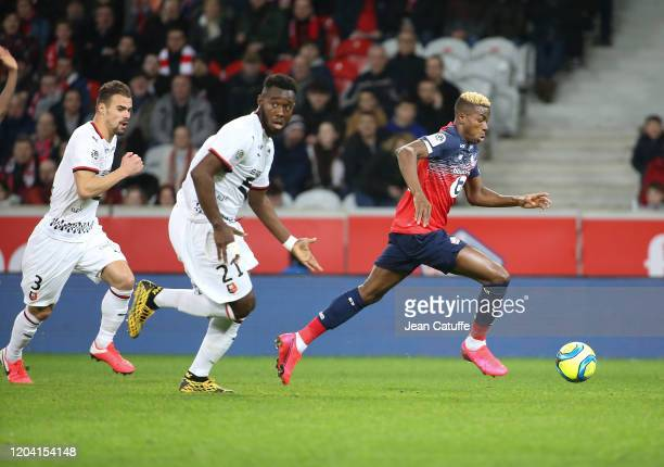 Victor Osimhen of Lille followed by Joris Gnagnon and Damien Da Silva of Stade Rennais during the Ligue 1 match between Lille OSC and Stade Rennais...
