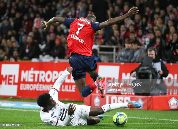 Victor Osimhen of Lille is tackled by Faitout Maouassa of Stade Rennais during the Ligue 1 match between Lille OSC and Stade Rennais at Stade Pierre...