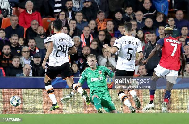 Victor Osimhen of Lille scores his team's first goal during the UEFA Champions League group H match between Valencia CF and Lille OSC at Estadio...