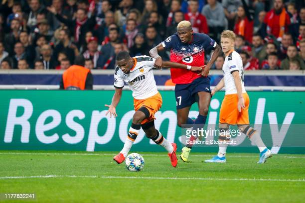 Victor Osimhen of Losc challenges Geoffrey Kondogbia of Valencia CF during the UEFA Champions League group H match between Lille OSC and Valencia CF...