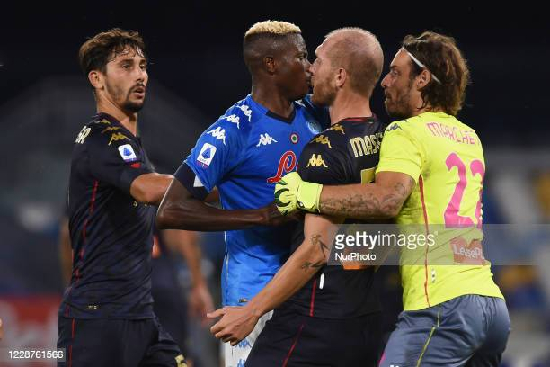 Victor Osimhen of SSC Napoli clashes with Andrea Masiello of Genoa CFC during the Serie A match between SSC Napoli and Genoa CFC at Stadio San Paolo...