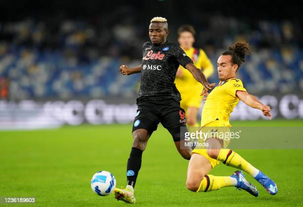 Victor Osimhen of SSC Napoli competes for the ball with Arthur Theate of Bologna FC ,during the Serie A match between SSC Napoli and Bologna FC at...