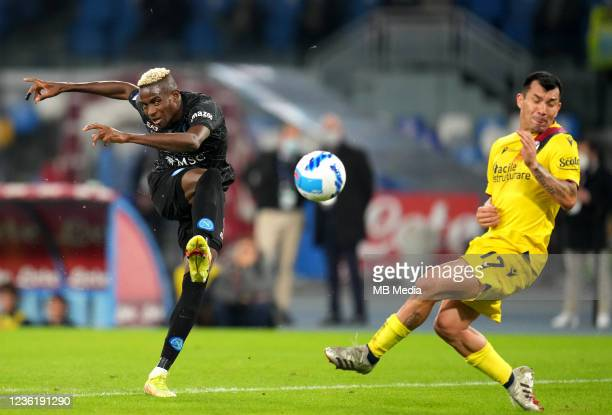 Victor Osimhen of SSC Napoli competes for the ball with Gary Medel of Bologna FC ,during the Serie A match between SSC Napoli and Bologna FC at...
