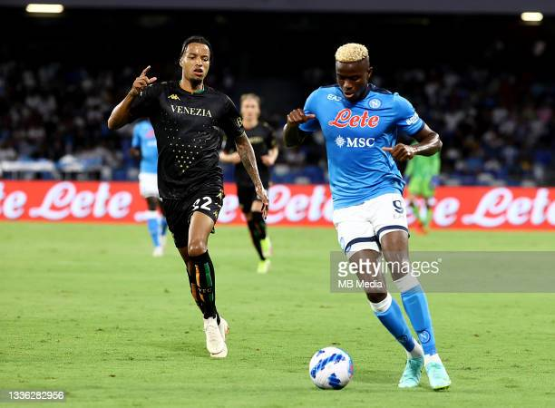 Victor Osimhen of SSC Napoli competes for the ball with Tyronne Ebuehi of Venezia FC ,during the Serie A match between SSC Napoli v Venezia FC at...