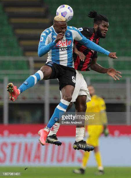 Victor Osimhen of SSC Napoli jumps for the ball against Frank Kessie of AC Milan during the Serie A match between AC Milan and SSC Napoli at Stadio...