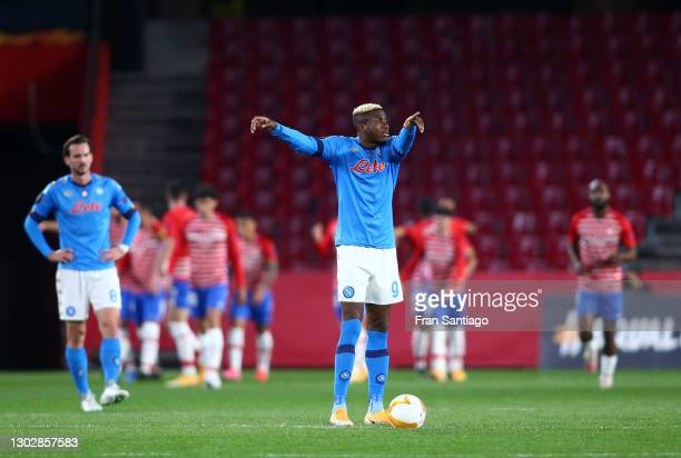 Victor Osimhen of SSC Napoli reacts as Kenedy of Granada CF scores their sides second goal during the UEFA Europa League Round of 32 match between...