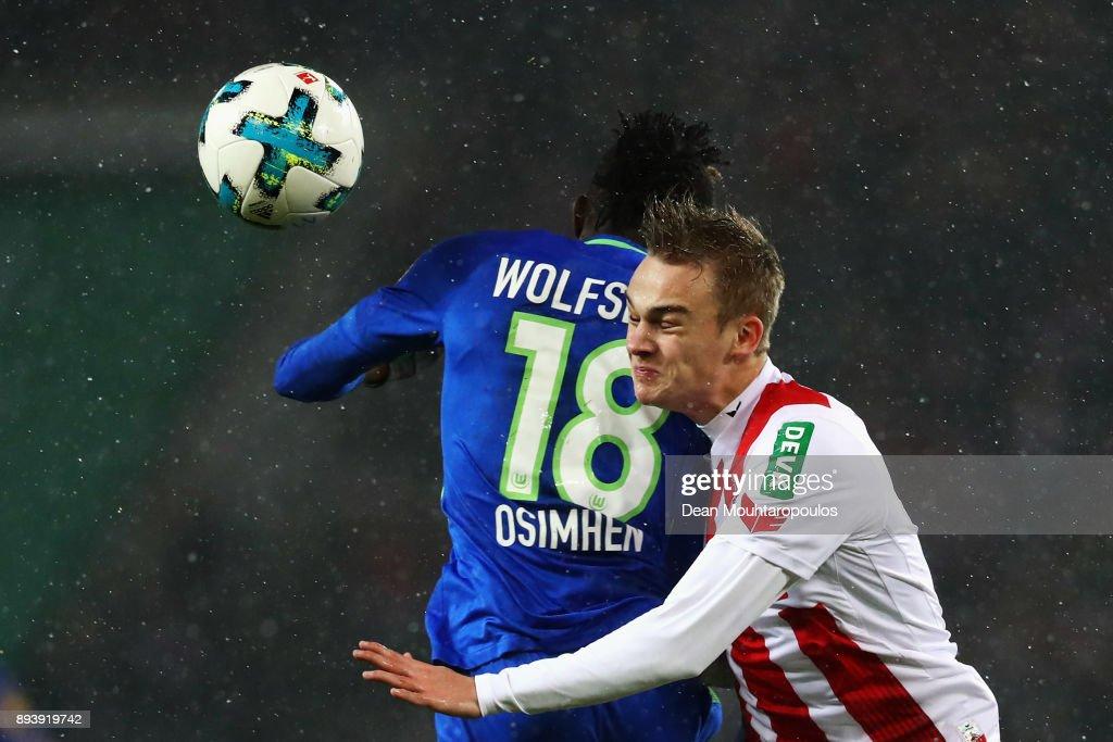 Victor Osimhen of Wolfsburg battles for the ball with Tim Handwerker of FC Koeln during the Bundesliga match between 1. FC Koeln and VfL Wolfsburg at RheinEnergieStadion on December 16, 2017 in Cologne, Germany.