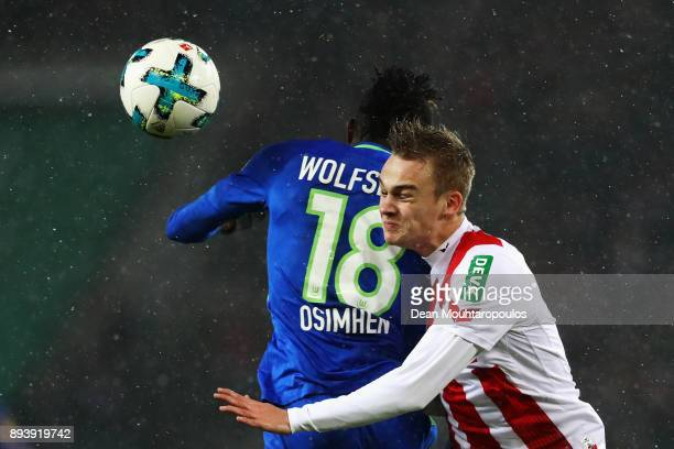 Victor Osimhen of Wolfsburg battles for the ball with Tim Handwerker of FC Koeln during the Bundesliga match between 1 FC Koeln and VfL Wolfsburg at...