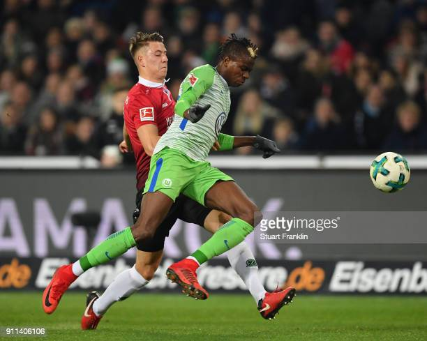 Victor Osimhen of Wolfsburg is challenged by Waldemar Anton of Hannover during the Bundesliga match between Hannover 96 and VfL Wolfsburg at HDIArena...