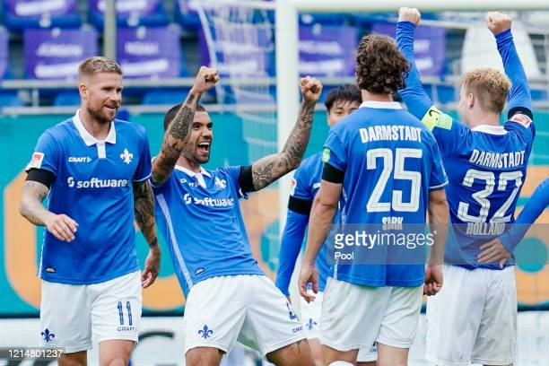 Victor Palsson of SV Darmstadt 98 celebrates with teammates following scoring his side's fourth goal during the Second Bundesliga match between SV...