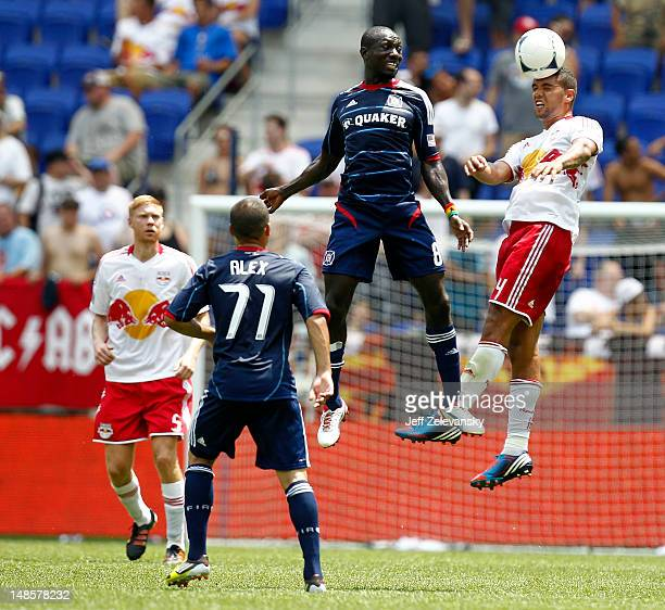 Victor Palsson of the New York Red Bulls heads the ball in front of Dominic Oduro of the Chicago Fire during their match at Red Bull Arena on July 18...