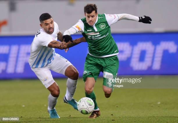 Victor Palsson of Zuerich and Tranquillo Barnetta of St. Gallen battle for the ball during the Raiffeisen Super League match between FC St. Gallen...