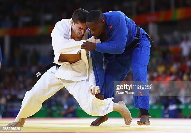 Victor Penalber of Brazil and Marlon Acacio of Mozambique compete during the Men's 81kg bout on Day 4 of the Rio 2016 Olympic Games at the Carioca...