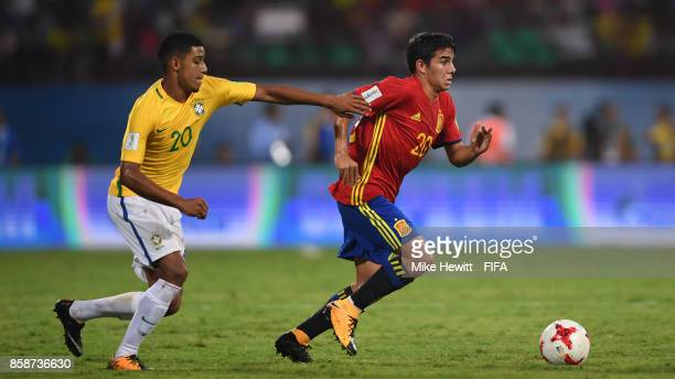 Victor Perea of Spain is challenged by Brenner of Brazil during the FIFA U17 World Cup India 2017 group D match between Brazil and Spain at the...