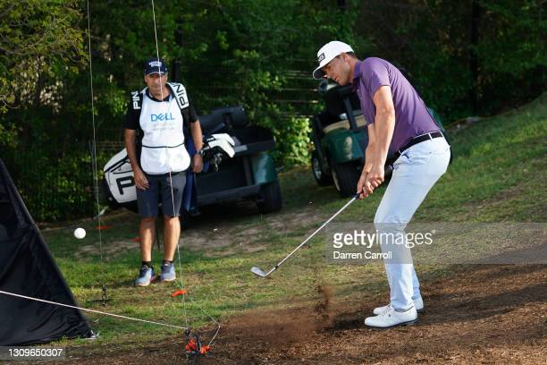 Victor Perez of France plays his shot on the 16th hole in his match against Matt Kuchar of the United States during the third place round of the...