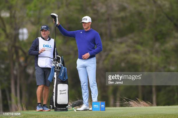 Victor Perez of France pulls his driver from the bag on the 16th tee box during the semifinal match at the World Golf Championships-Dell Technologies...