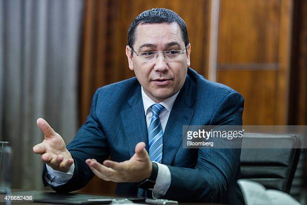 Victor Ponta Romania's prime minister gestures whilst speaking during an interview at the Victoria Palace in Bucharest Romania on Thursday June 11...