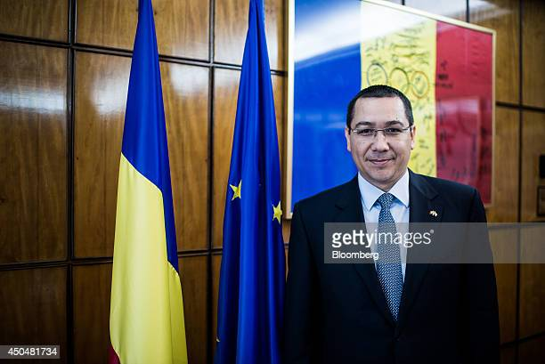 Victor Ponta Romania's prime minister poses for a photograph at the Victoria Palace in Bucharest Romania on Thursday June 12 2014 Romania is...