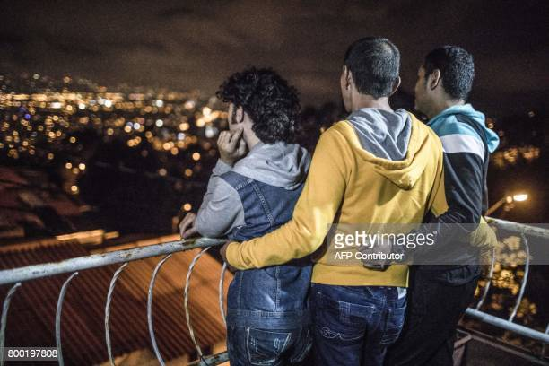 Victor Prada Alejandro Rodriguez and Manuel Bermudez stand on the balcony at their home in Medellin Colombia on June 17 2017 The three men have...
