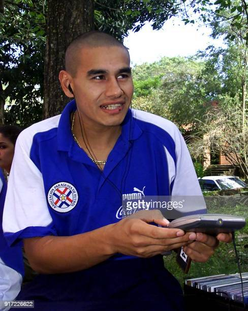 Victor Quintana player of the Paraguayan soccer team listens to music 01 June 2001 outside the Sol de San Ber Hotel in San Bernardino 40 km of...
