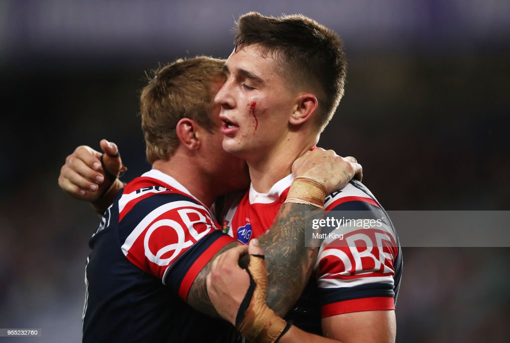 Victor Radley of the Roosters (R) celebrates victory with Jake Friend of the Roosters (L) at the end of the round nine NRL match between the Sydney Roosters and the Manly Warringah Sea Eagles at Allianz Stadium on May 6, 2018 in Sydney, Australia.