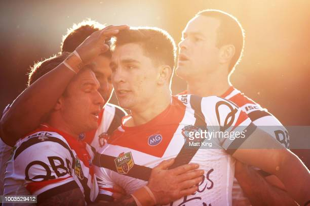 Victor Radley of the Roosters celebrates with team mates after scoring a try during the round 19 NRL match between the Manly Sea Eagles and the...