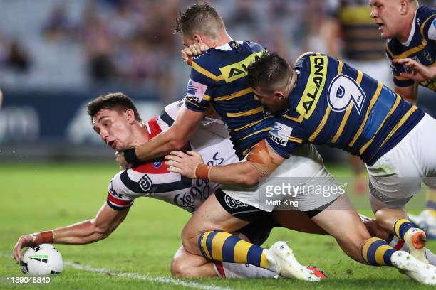 Victor Radley of the Roosters scores a try during the round three NRL match between the Parramatta Eels and the Sydney Roosters at ANZ Stadium on...