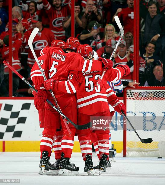Victor Rask Noah Hanifin and Jeff Skinner of the Carolina Hurricanes celebrate a goal scored by Bryan Bickell against the New York Rangers on October...