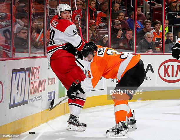 Victor Rask of the Carolina Hurricanes and Radko Gudas of the Philadelphia Flyers fight for the puck in the first period on November 23 2015 at the...