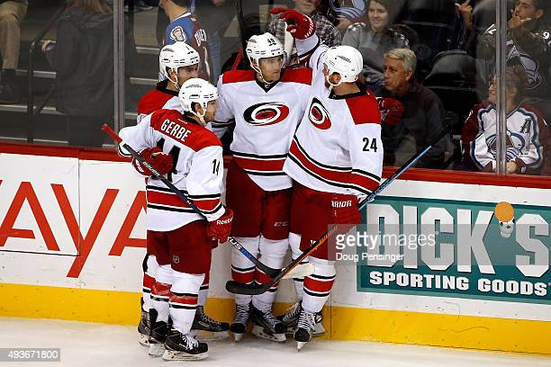 Victor Rask of the Carolina Hurricanes celebrates his game winning goal against the Colorado Avalanche in overtime with Ryan Murphy Brad Malone and...