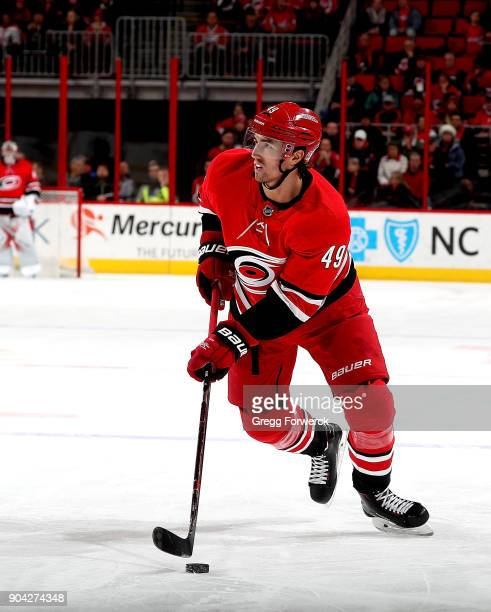 Victor Rask of the Carolina Hurricanes controls the puck during an NHL game against the Washington Capitals on January 2 2018 at PNC Arena in Raleigh...