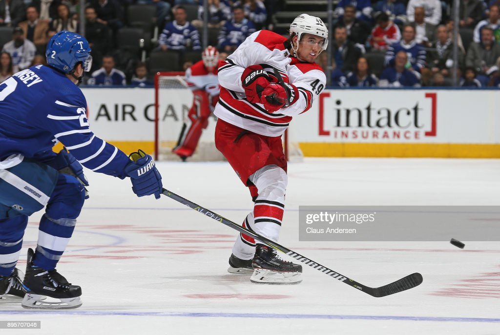 Victor Rask #49 of the Carolina Hurricanes fires a shot in past Ron Hainsey #2 of the Toronto Maple Leafs during an NHL game at the Air Canada Centre on December 19, 2017 in Toronto, Ontario, Canada. The Maple Leafs defeated the Hurricanes 8-1.