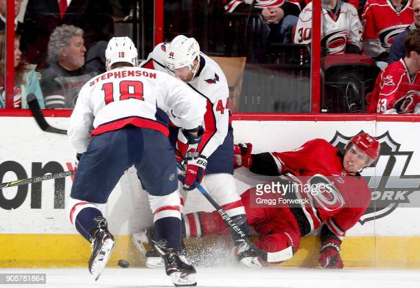 Victor Rask of the Carolina Hurricanes gets upended near the boards by Brooks Orpik of the Washington Capitals during an NHL game on January 12 2018...