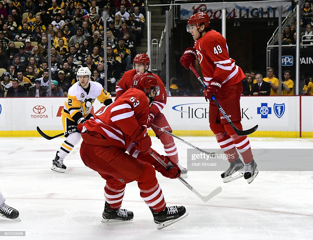 Victor Rask #49 of the Carolina Hurricanes jumps out of the way of athe puck against the Pittsburgh Penguins at PPG PAINTS Arena on December 28, 2016 in Pittsburgh, Pennsylvania.