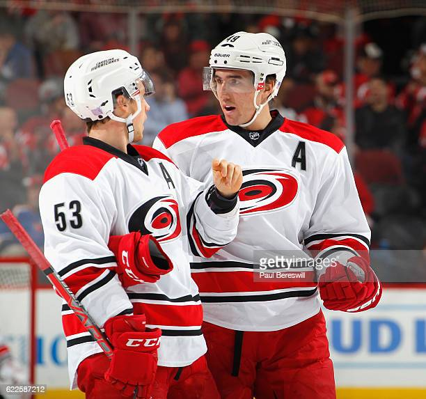 Victor Rask of the Carolina Hurricanes talks with teammate Jeff Skinner during a break in action in an NHL hockey game against the New Jersey Devils...