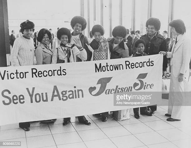 Victor Records presented the Jackson Five family with a banner as they were about to depart Asia after a very successful tour left to right Tito...