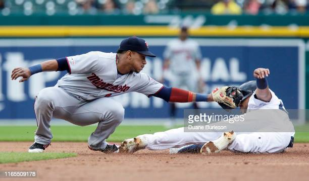 Victor Reyes of the Detroit Tigers avoids the tag from shortstop Jorge Polanco of the Minnesota Twins to steal second base during the first inning at...