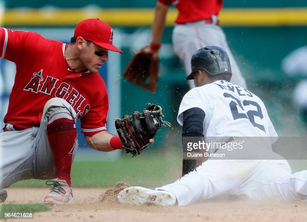 Victor Reyes of the Detroit Tigers beats the tag from second baseman Ian Kinsler of the Los Angeles Angels of Anaheim to steal second base during the...