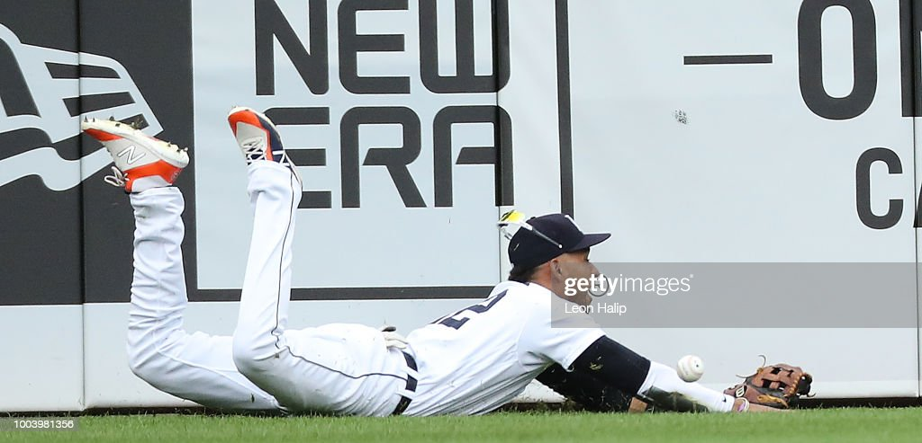 Victor Reyes #22 of the Detroit Tigers dives the the line drive off the bat of Andrew Benintendi #16 of the Boston Red Sox in the seventh inning of the game at Comerica Park on July 22, 2018 in Detroit, Michigan.