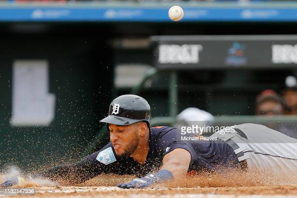 Victor Reyes of the Detroit Tigers slides safely into home after scoring a run in the fifth inning against the St Louis Cardinals during the...