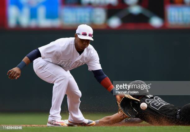 Victor Reyes of the Detroit Tigers steals second base against Jorge Polanco of the Minnesota Twins during the third inning of the game on August 25...