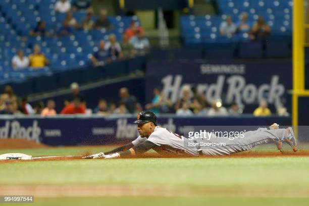 Victor Reyes of the Tigers slides safely into third base during the MLB regular season game between the Detroit Tigers and the Tampa Bay Rays on July...
