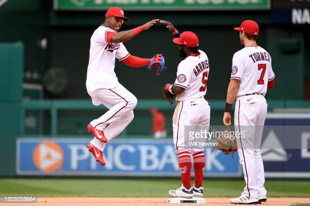 Victor Robles and Josh Harrison of the Washington Nationals celebrate after defeating the San Francisco Giants in game one of a doubleheader at...
