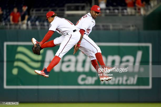 Victor Robles and Wilmer Difo of the Washington Nationals celebrate after defeating the St Louis Cardinals at Nationals Park on May 2 2019 in...