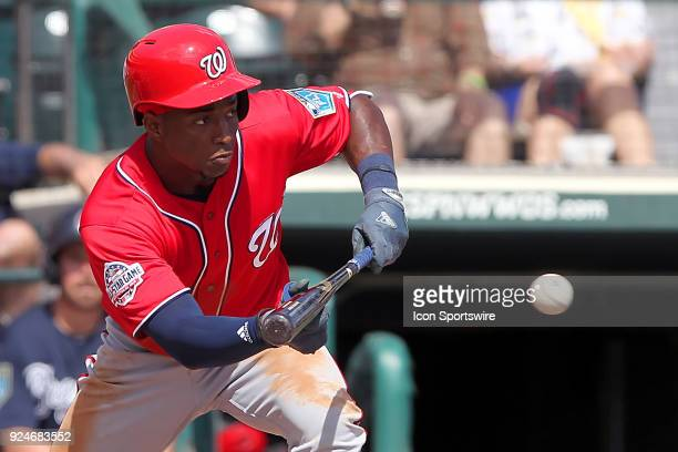 Victor Robles of the Nationals attempts to lay down a bunt for a hit during the spring training game between the Washington Nationals and the Atlanta...